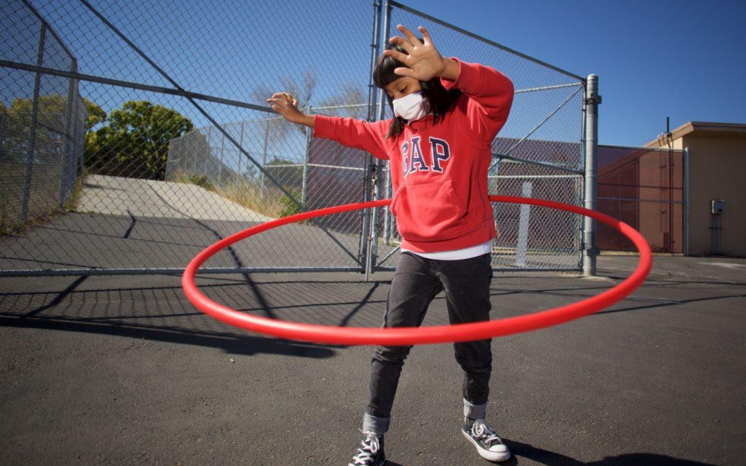 Empower Language academy student hula hoops outside